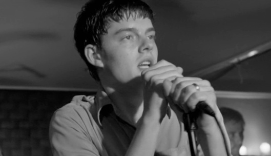 Sam Riley as Ian Curtis.