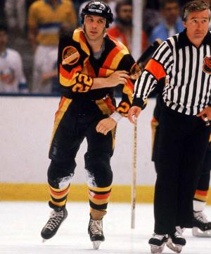 Tiger Williams, the NHL's all-time penalty minutes leader and goon supreme. (Notice the absolutely gorgeous Vancouver Canucks uniform)
