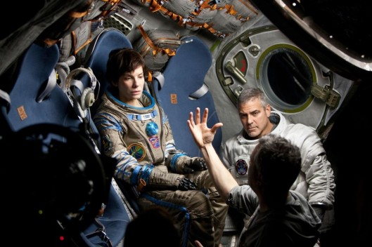 Cuaron on set with Bullock and Clooney.