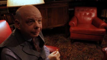 Wallace Shawn, doing the mental gymnastics with Warren (Dan Fogler).