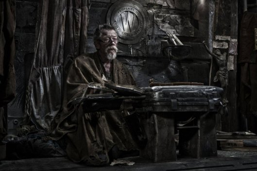 Gilliam (John Hurt), sage of the tail section.